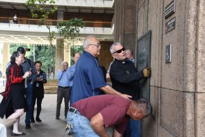 Central Services Division removing the plaque