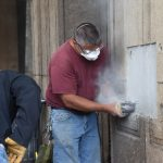 Cutting into the concrete covering the Time Capsule