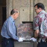 Senator Taniguchi and State Archivist Jansen carefully extricating the Time Capsule